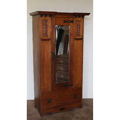 A Quality Art Nouveau Carved Oak Mirror Fronted Single Door Wardrobe