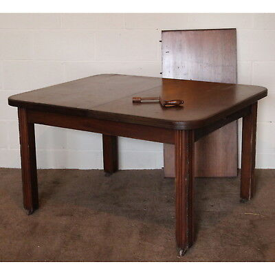 An Edwardian Mahogany Wind Out Dining Table with Extra Leaf & Handle
