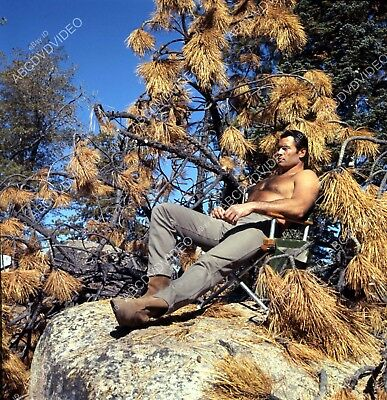 8b20-17245 shirtless Clint Walker relaxes in the sun between takes TV Cheyenne 8