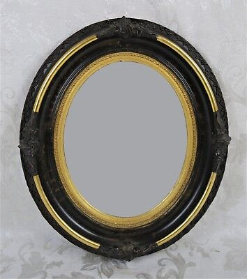Antique 19th Century Gold Gilt Gesso Black Oval Mirror With Ornate Floral Design