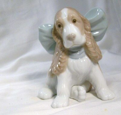 Lladro/nao A Cute Little Dog With A Big Blue Bow Round His Neck
