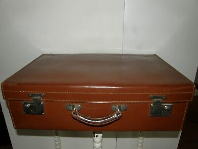 Antique Leather Suitcase With Silk Lining.
