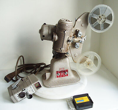 Bell & Howell 16mm FILM Projector MODEL 606H and ONE-NINE 8MM MOVIE CAMERA
