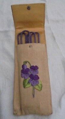 Art Deco folding coat hangers in hand embroidered case