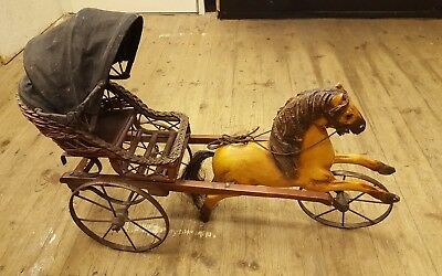 A vintage wicker & wooden horse and buggy 104