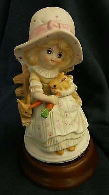 Vintage Price Products Rotating Music Box Porcelain Figurine Girl feeding Rabbit