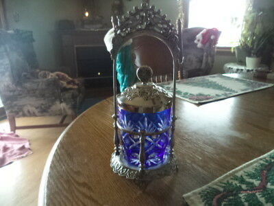gorgeous silver plate pickle castor with blue cut glass pickle jar.