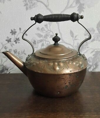 An Antique Copper Kettle, Embossed