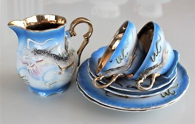 Blue and gold 'Dragon Ware' grouping.