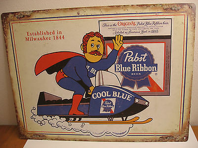 """Pabst Cool Blue Man Snowmobile Metal Sign Beer 24""""x18"""" Sports Bar Man Cave Hang"""