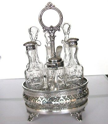 Antique Silver Plate Cruet Set; Six Glass Containers Stoppers And Mustard Spoon