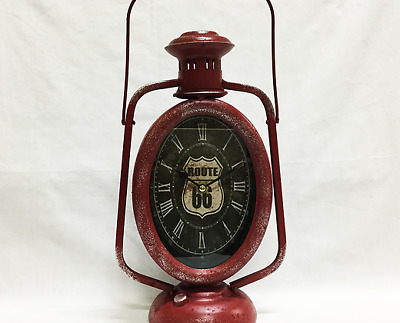 Vintage Looking Metal Red Lantern Clock with Route 66 printed on it.