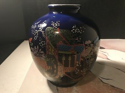 Vintage Kutani Tousen Vase With A Deep Blue Finish With Hand Painted Rickshaw.