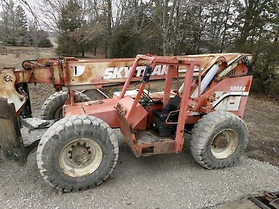 skytrak 10054 new tires comes with bucket and forks
