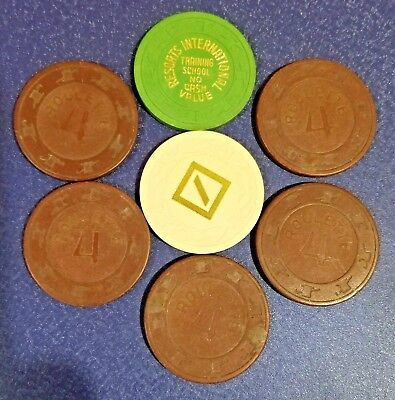 7 Casino Chips Obsolete - one is Resorts Int. Training School $25- No Cash Value