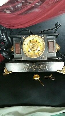 Antique clock 1882. Ansonia New York USA Iron Mantel Clock with Lion Heads.
