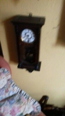 small antique wall clock