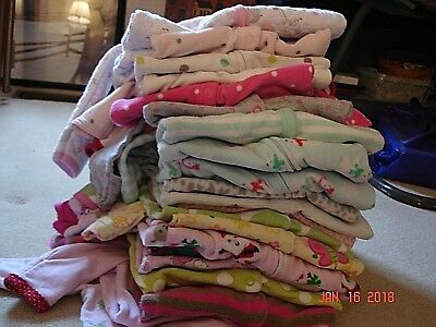Lots of baby girls sleepers different styles, patterns, sizes, and fabrics