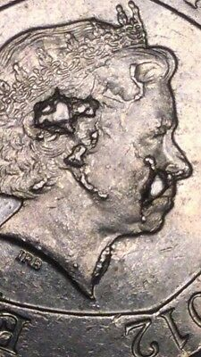 20 pence multiple minting  error large cuds  on face very rare