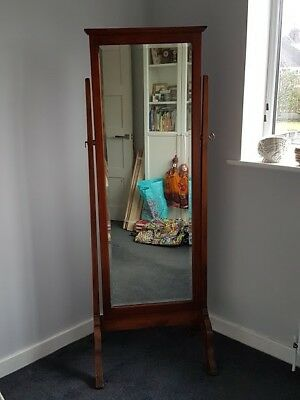 Antique solid wood cheval mirror. Possibly mahogany.