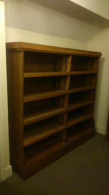 solid oak bookcase ex library used as shop fitting