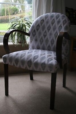 A pair of newly reupholstered chairs in a soft ikat style material