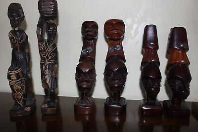 Six Wood carved African figures.