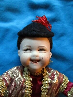 Artist made ethnic porcelain doll   -Chinese man -marked CLEO