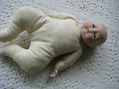 Porcelain baby doll..cloth body