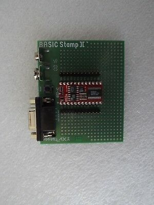 Parallax BS2E-IC Basic Stamp 2 Module seated on BS2-IC Carrier Board and parts.