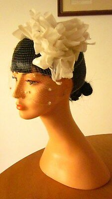 1950,s fab white/cream headpiece with leaves and full face spotted veil.Preloved