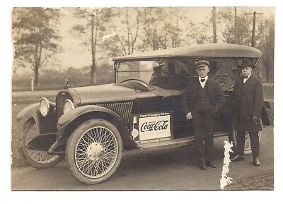 Coca-Cola RPPC postcard showing a straight sided bottle sign on car Erie, PA
