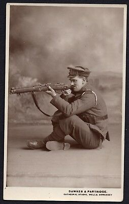 WW1 A.S.C. DESPATCH RIDER, POSED WITH RIFLE, ACTION PORTRAIT, WELLS, No.2. RPPC.