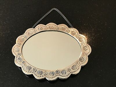 A Continental Silver reposse oval antique wedding mirror, possibly Turkish