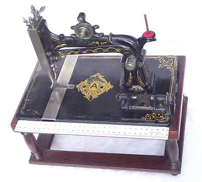 Antique Collectable very rare Jones Howe sewing machine head on display stand.