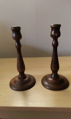 pair of turned wooden candlesticks