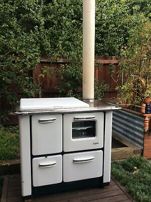 slow combustion wood fired stove oven  pizza oven vintage