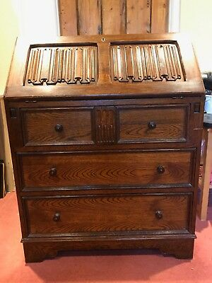 Antique dark oak, solid wood writing bureau with folding shelf, linenfold design