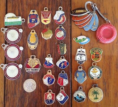 31 various key ring club membership tags. Location and condition as noted