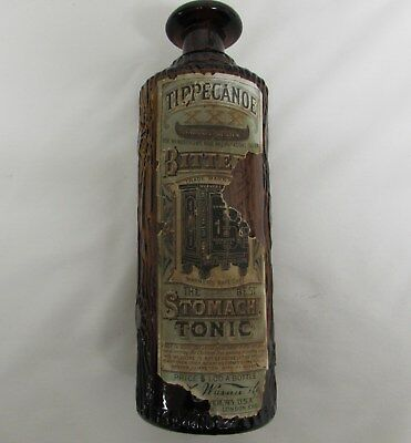 H.H.Warner's Tippicanoe figural bottle with a Bitters Stomach Tonic Label