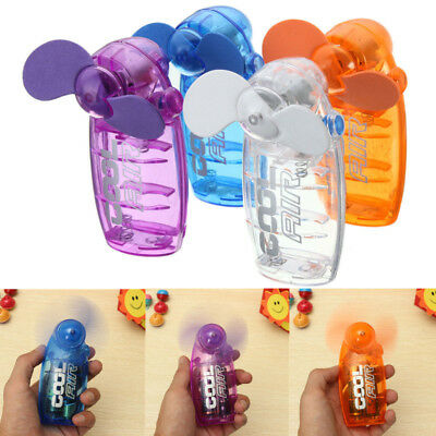 Mini Portable Pocket Fan Cool Air Hand Held Battery Button Type Blower Cooler