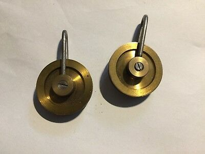 pair 8 day longcase brass and steel pulleys new old stock for spares or repair