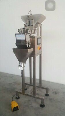 Linear feed bag filler weigher
