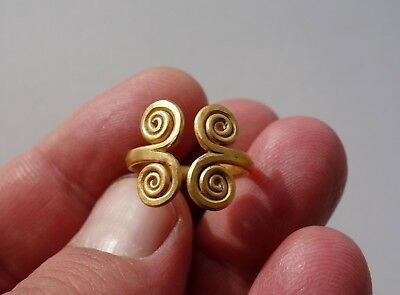superb ancient Viking solid gold ring,having a four spirals at the two terminals