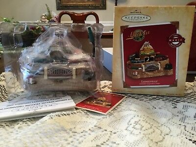 Hallmark Keepsake Lionelville Light Magic Motion Sound Ornament 2004 with Box