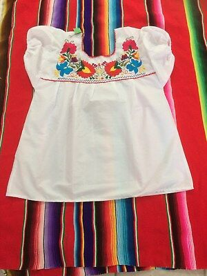 Embroidered Mexican blouse.new item.