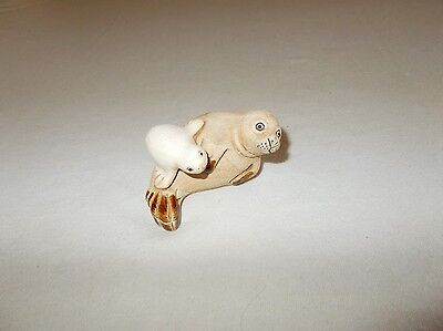 Small sized hand crafted mother seal and baby pup collectible miniature figurine