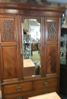 Antique Victorian Mahogany Wardrobe With two small over one large Drawer.