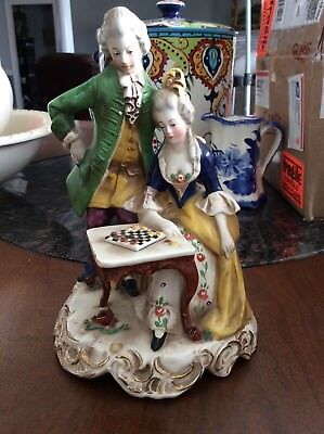 Antique German Figurine of a couple playing checkers marked N.M. #568