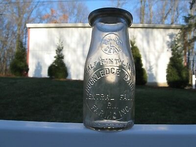 RD EMB slug half pint MILK BOTTLE ROCKLEDGE DAIRY CENTRAL FALLS RHODE ISLAND